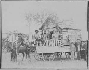 Primary view of object titled '[Photograph of Horse-Drawn Cabin]'.
