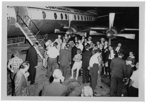 Primary view of object titled '[Crowd Gathered Outside of a Continental Airliner]'.