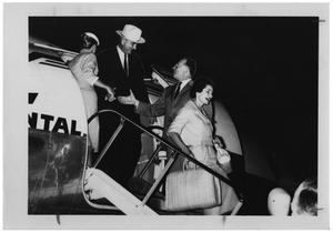 [Lyndon B. Johnson, Lady Bird, and Others Exiting From an Airplane]