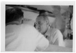 Primary view of object titled '[Lyndon Johnson Sitting in an Airplane]'.