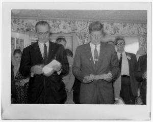 Primary view of object titled '[Lyndon Johnson and John Kennedy Reading Letters]'.