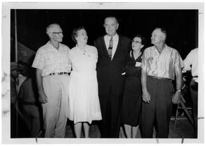 Primary view of object titled '[Lyndon Johnson Standing with His Arms Around Four People]'.