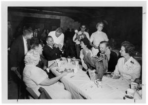 Primary view of object titled '[Lyndon Johnson Sitting at the Head of a Table with Others]'.