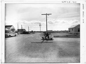 Primary view of object titled '[Lyndon Johnson Driving a Three Wheeled Cart]'.