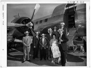 Primary view of object titled '[Johnsons Standing with People in Front of an Airplane]'.