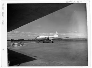 Primary view of object titled '[Airplane on a Runway Near a Gas Pump]'.