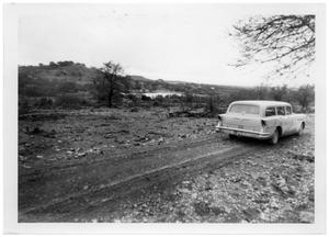 Primary view of object titled '[Station Wagon on a Dirt Road]'.