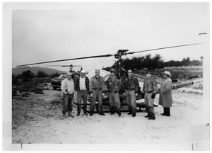 Primary view of object titled '[Men in Front of a Helicopter]'.