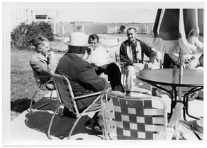 Primary view of object titled '[Lyndon Johnson and Other Men Sitting Around a Table]'.