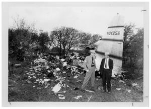 Primary view of object titled '[Two Men at the Wreckage of an Airplane]'.