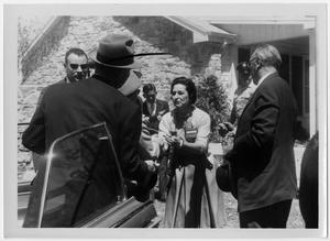 Primary view of object titled '[Lady Bird Johnson with Men Outside of the Texas White House]'.