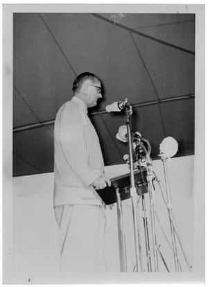 Primary view of object titled '[Lyndon Johnson Standing in Front of Microphones]'.
