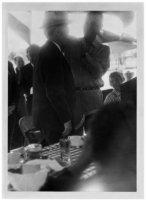 Primary view of object titled '[Lyndon Johnson Holding a Man's Hat]'.