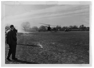 Primary view of object titled '[Helicopters and Onlookers in a Field]'.