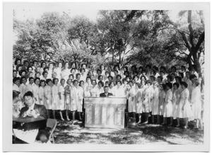 Primary view of object titled '[Female Choir Outdoors with a Pianist]'.