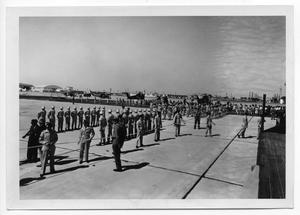 Primary view of object titled '[Military Personnel Lined Up on a Runway]'.