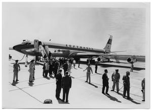 Primary view of object titled '[Ludwig Erhard Stepping Out of an Airplane]'.