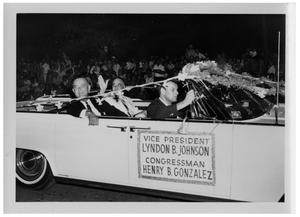 Primary view of object titled '[Lyndon Johnson and Henry B. Gonzalez in a Car Passing a Crowd]'.