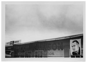 Primary view of object titled '[Lyndon Johnson Political Advertisement on the Side of a Building]'.