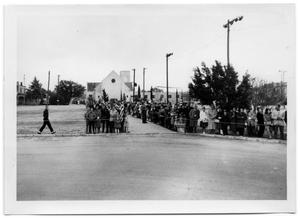 Primary view of object titled '[People Cordoned Off Around Bethany Lutheran Church's Driveway]'.