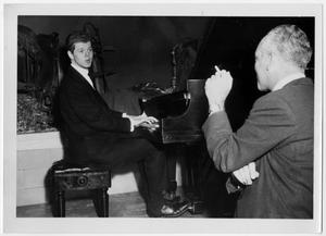 "Primary view of object titled '[Harvey Lavan ""Van"" Cliburn, Jr. Speaking with an Unidentified Man]'."