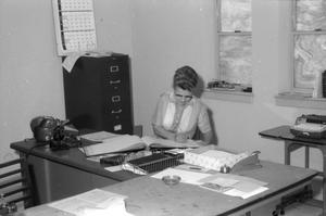 Primary view of object titled '[Woman at Desk in First United Methodist Church['.