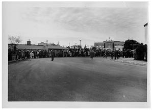 Primary view of object titled '[People Standing Around a Cordoned Street]'.