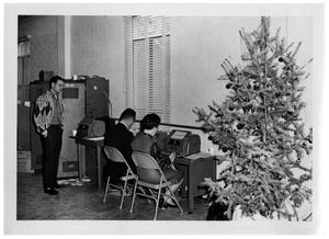 Primary view of object titled '[Typewriters and a Christmas Tree]'.