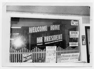Primary view of object titled '[Storefront with Signage Welcoming the President]'.