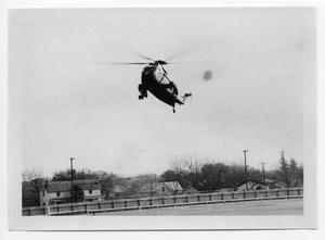 Primary view of object titled '[Helicopter Over a Field]'.