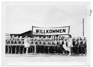 "Primary view of object titled '[Fredericksburg High School Band with a ""Willkommen"" Banner]'."