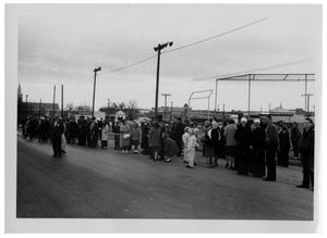 Primary view of object titled '[People Standing on the Side of a Street]'.
