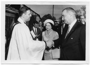 Primary view of object titled '[Lyndon and Lady Bird Johnson Meeting Priest]'.