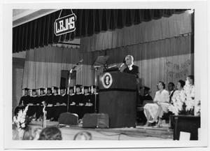 Primary view of object titled '[Lyndon Johnson Speaking at a High School Graduation]'.