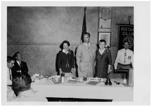 Primary view of object titled '[Lyndon Johnson with Two Women at Rotary Meeting]'.
