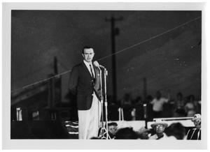 Primary view of object titled '[Man Speaking at a Microphone]'.