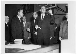 Primary view of object titled '[Lyndon Johnson in a High School Basketball Court]'.