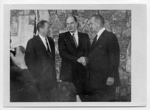 Primary view of object titled '[Lyndon Johnson Shakes Hands with Another Man]'.