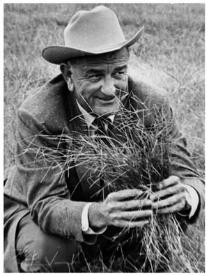 Primary view of object titled '[Lyndon Johnson Holding Hay]'.