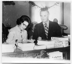 Primary view of object titled '[Lady Bird and Lyndon Johnson at a Book Signing]'.