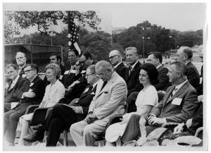 [Lyndon Johnson Sitting with Rows of People]