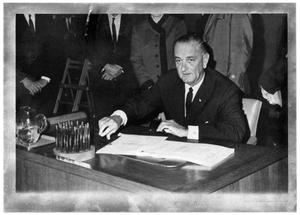 Primary view of object titled '[Lyndon B. Johnson Sitting at a Desk]'.