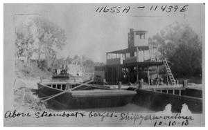 Primary view of object titled 'Steamboat and barges docked on the Guadalupe River'.