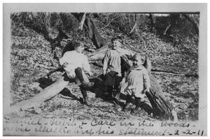 Daniel, Nevill and Carl in the woods.  Nevill illustrating his statement.