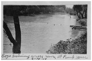 Primary view of object titled 'Boys swimming across river, at pump house'.