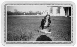 Primary view of object titled '[Dorothy Katt Sitting on Lawn]'.