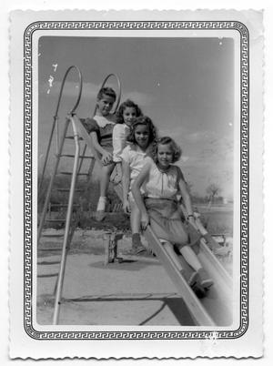 Primary view of object titled '[Four Girls on Slide]'.