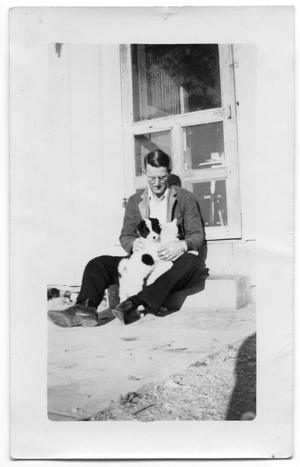 Primary view of object titled '[Mr. Watts With Puppy]'.