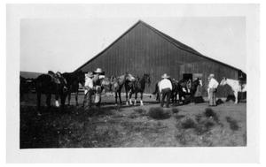 Primary view of object titled '[Cowboys and Horses in front of a Barn]'.