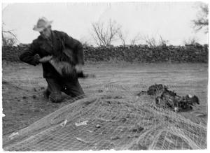 Primary view of object titled '[Man and Captured Turkeys]'.